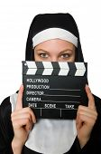 Nun with movie board isolated on white