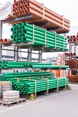 foto of sewage  - Plastic pipes stacked in a factory or warehouse yard for use in plumbing or sewage installations on a construction site - JPG