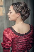 foto of medieval  - Portrait of young beautiful medieval woman in red dress - JPG