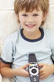 Young boy with remote control