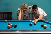 Couple Playing Billiard