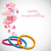 Colourful bands on heart shape decorated grey background for Happy Friendship Day celebrations.