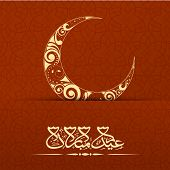 Arabic islamic calligraphy of text Eid Mubarak with floral design decorated crescent moon on maroon