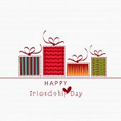 Colourful gift boxes on white background for Happy Friendship Day celebrations.