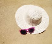 a floppy beach hat and sunglasses