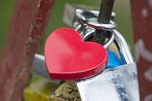 Love padlock on the railing of a bridge