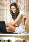 Girl With Notebook Computer At Home