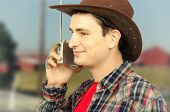 Cheerful Young Cowboy Listening To The Radio