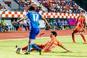 Sisaket Thailand-june 21: Gorka Unda Of Sisaket Fc. (orange) Slide The Ball During Thai Premier Leag