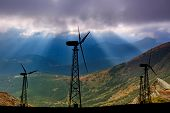 Windmills On The Background Of Mountain Scenery