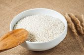 rice cereal and wooden spoon on burlap background