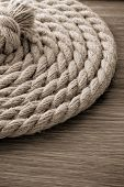 ship ropes on wooden background