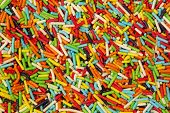 Colorful small sweet sugar sticks. Candy, cakes, cookies eatable decoration. Background, pattern.