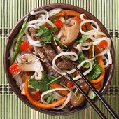Rice Noodles With Meat, Mushrooms And Cilantro  Top View