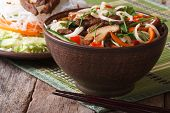 Asian Food: Rice Noodles With Shiitake And Vegetables In A Bowl