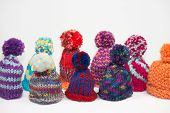 picture of knitted cap  - crowd of knitted bobble caps using for egg cozy and warm - JPG