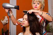 Hairdresser Making Hair Of Beautiful Happy Girl