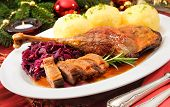 Crusty goose leg with braised red cabbage and dumplings