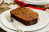 picture of chocolate-chip  - chocolate bread with chocolate chips on a dark wood background