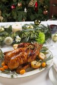 pic of kumquat  - Citrus glazed roasted duck stuffed with rice garnished with apples kumquats and sage - JPG