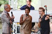 NEW YORK-AUG 22: Country music singer Hunter Hayes (R) speaks with Matt Lauer (L) and Tamron Hall during his concert at NBC's 'Today Show' at Rockefeller Plaza on August 22, 2014 in New York City.