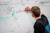 Student Writing Math On Whiteboard
