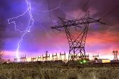 picture of smart grid  - Dramatic Image of Power Distribution Station with Lightning Striking Electricity Towers - JPG