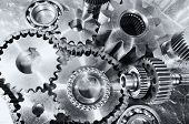 engineering, cogwheels, gears and chains, titanium and steel
