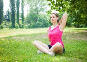 Young woman doing stretching at the park