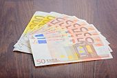Close-up of Euro banknotes on the table