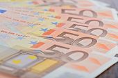 Close-up of 50 Euro banknotes on the table