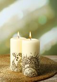 Beautiful spa composition with decorative Indian candles, on light background