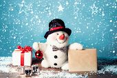 Snowman with letter and gifts