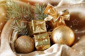 Beautiful Christmas decor on golden satin cloth