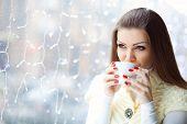 Beautiful girl drinking morning coffee in the cafe.