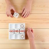 stock photo of tic-tac-toe  - Game of Tic Tac Toe on wooden background - JPG