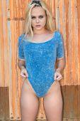 image of bodysuit  - Pretty petite blonde in a blue bodysuit - JPG