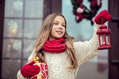 foto of guest-house  - Child girl welcome guests and holding presents - JPG
