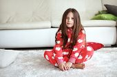 picture of pajamas  - Portrait of child in soft warm pajamas sitting on the carpet at home - JPG