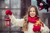 picture of guest-house  - Child girl welcome guests and holding presents - JPG