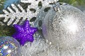 Silvery New Year's ball and decorative snowflake small depth of sharpness
