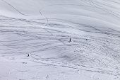 Silhouettes Of Snowboarders And Skiers On Off Piste Slope
