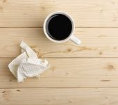 Cup Of Coffee And Crumpled Paper