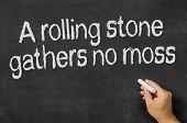 A rolling stone gathers no moss written on a blackboard