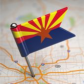 Arizona Small Flag on a Map Background.