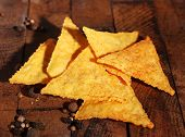 Tasty nachos on wooden background