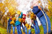 View from below of kids diversity in autumn park