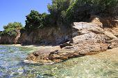 Stone ledge into the Aegean Sea.