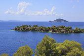 Kelyfos Island on the horizon of the Aegean Sea.