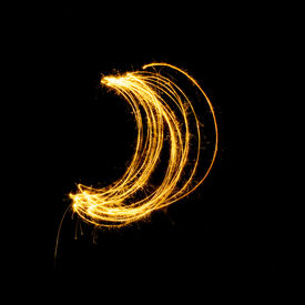 picture of crescent-shaped  - Sparkler firework light with crescent shape isolated on black background - JPG